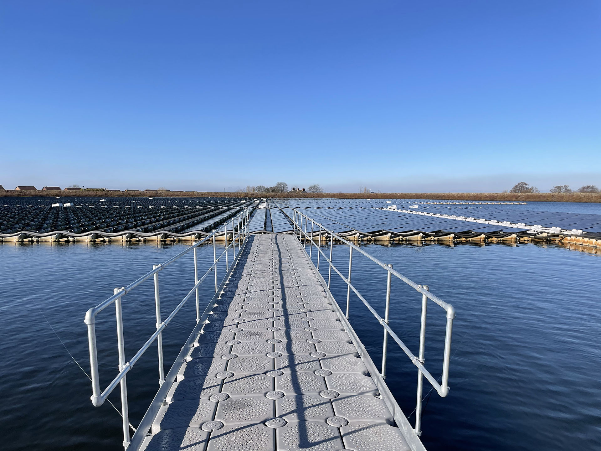 floating walkway out to floating solar panels on reservoir
