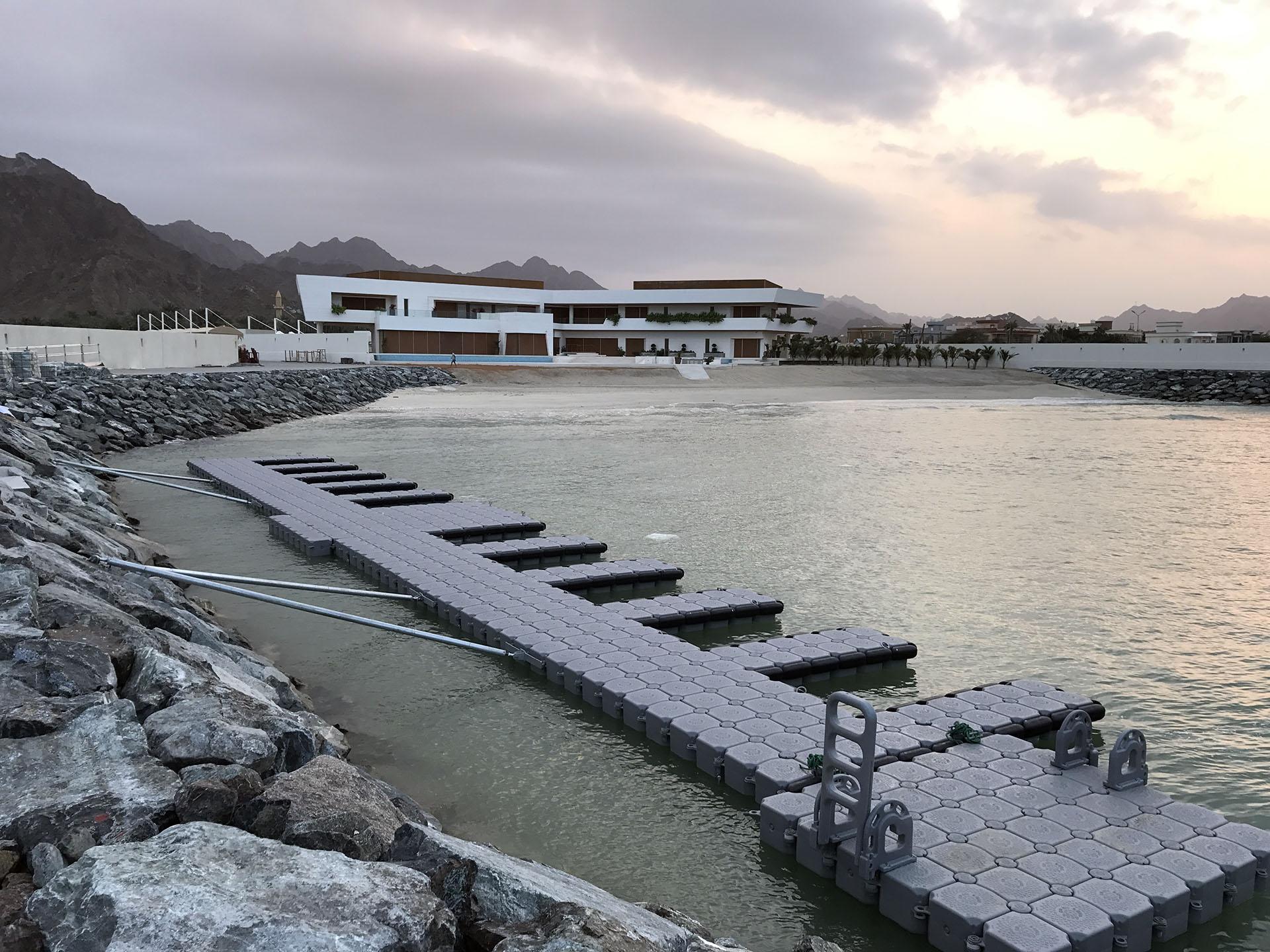 floating dock outside huge residence on the beach