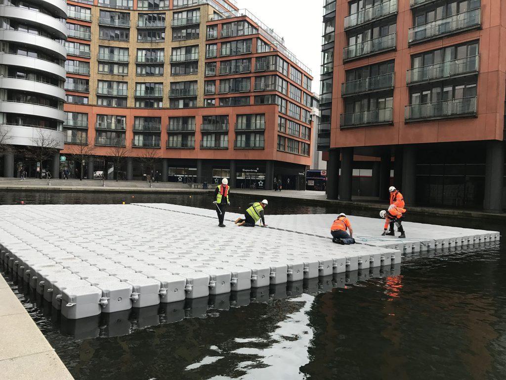 floating platform on unused water between apartment buildings
