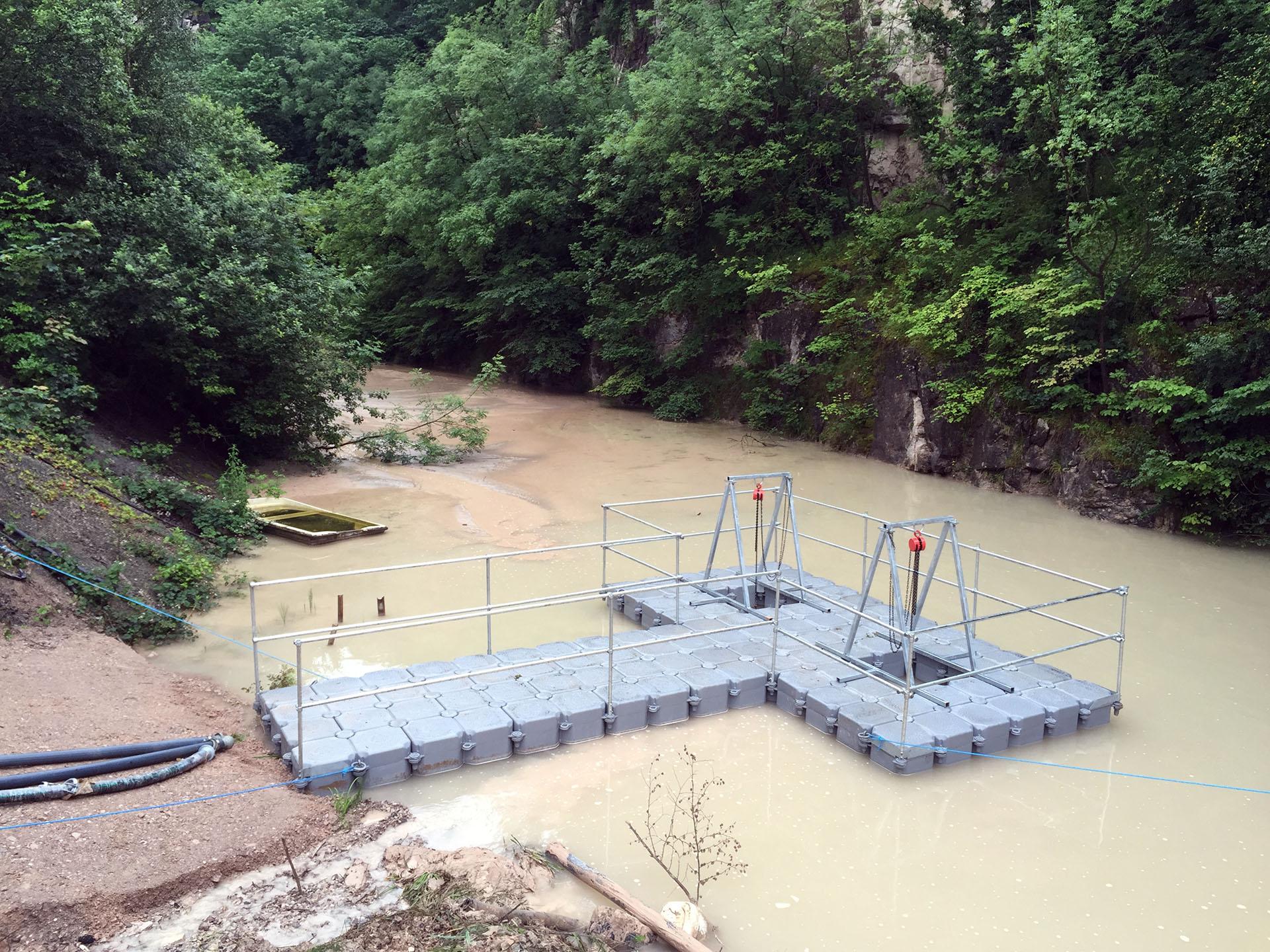 floating platform for work on muddy river