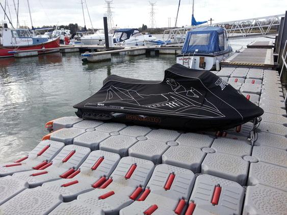 floating dock with jet ski parked