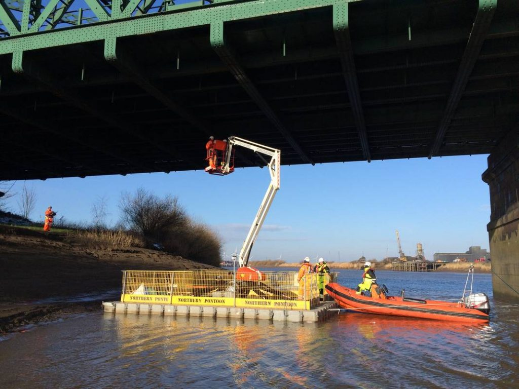 floating platform under bridge for repair